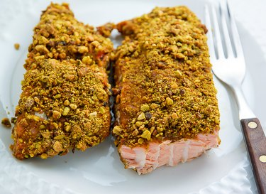 Baked pistachio-crusted salmon ready to be served.
