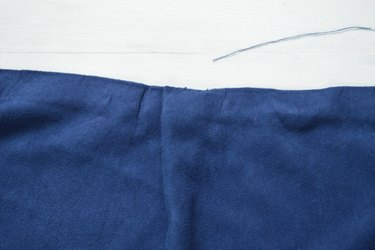 Tie the thread tightly to secure