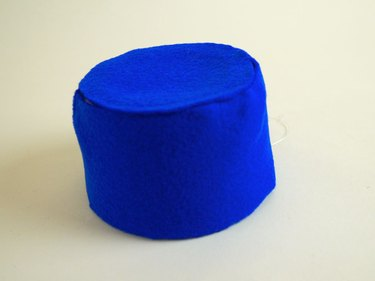 The tub covered in blue felt.