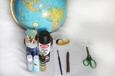 Supplies needed to create a painted globe.