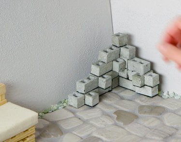 All blocks stacked into planter