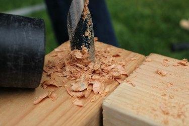 Vacuum up wood shavings as you go