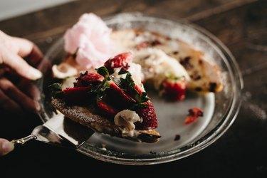 Generously slice the Dutch Baby pancake!