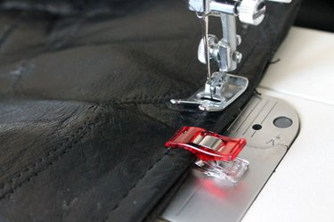 Use a 110/18 needle to restitch the zipper opening.