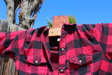 Wood and shirt attached to post.
