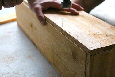 Hammering nail into wood