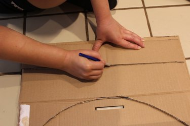 Readying to cut the cardboard.