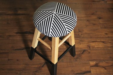 Upholstered and painted stool.