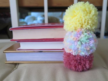 The yarn pompom bookmarks stacked.