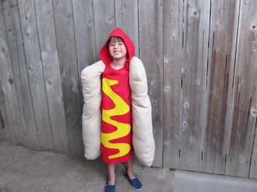 little boy in hot dog costume