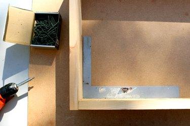 make a rectangle box shape, use carpenter square to ensure correct shape   how to make an elevated planter box