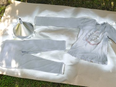 Clothing and funnel sprayed with silver paint.