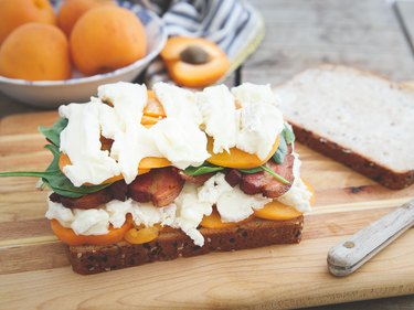 Assembling apricot brie and bacon grilled cheese