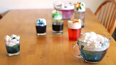 Variety of containers and colors of shaving cream clouds