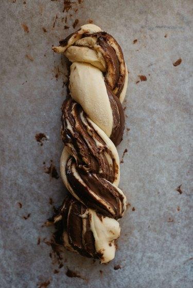 Braid the dough pieces together to form a log shape.