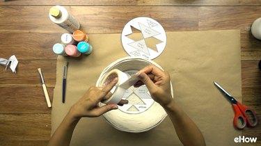 Attaching stencil to basket for DIY desert-style baskets.