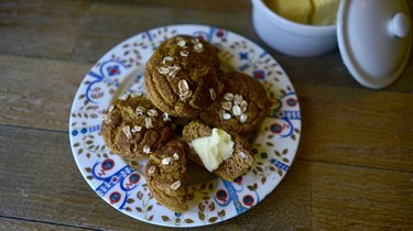 Fresh-baked pumpkin maple oat blender muffins topped with oats and cinnamon