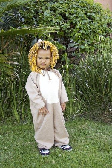Child in lion costume