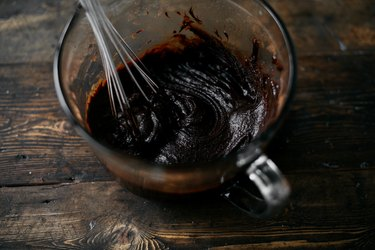 Whisk the brownie batter until it is very smooth, thick and glossy.