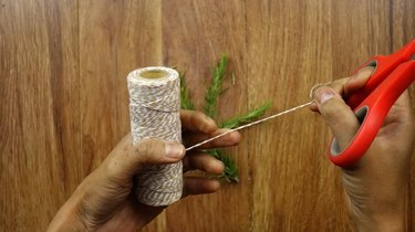 Cutting string for Christmas wreath gift tags.