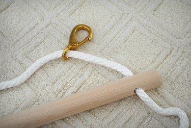 Slide rope through spring loaded hook