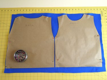 The two templates pinned to blue felt.