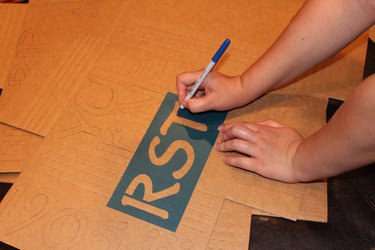 Creating letters from cardboard.