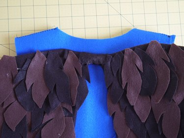 The wings attached to the back of the vest.
