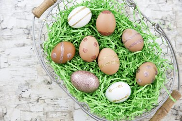 Basket of eggs decorated with glitter.