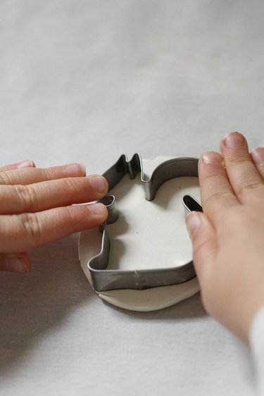 Press the cookie cutter into the clay to make the marker