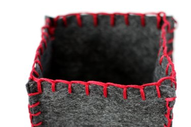 Use a blanket stitch around the top