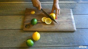 Preparing citrus slices for freezing.