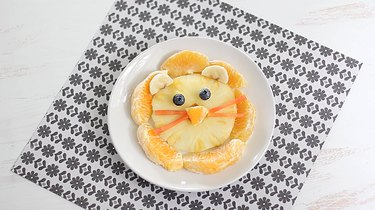 Plated lion face fruit snack