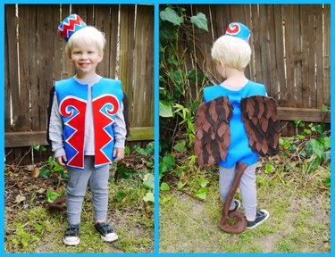 A toddler in a felt monkey costume, front and back.