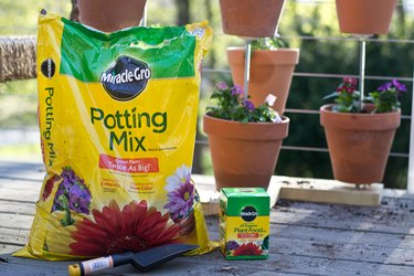 Miracle Gro Potting Mix and Fertilizer.