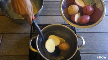 Blanching potatoes before freezing.