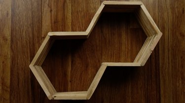 Unfinished hexagon shelf out of popsicle sticks