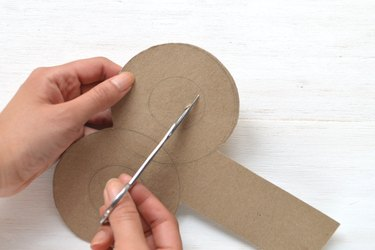 Create a hole by cutting out the small circle.
