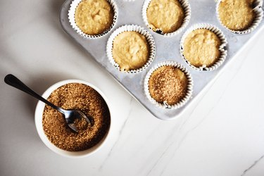 Sprinkle about a teaspoon of raw sugar on top of each muffin.