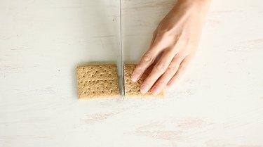 Slicing graham cracker in half