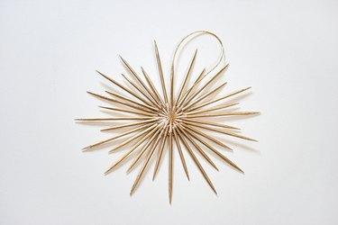 Glue ribbon hanger to sunburst ornament.
