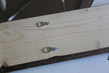 Hanging hardware attached to the back of the board