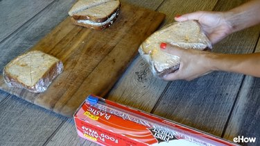 Wrapping sandwiches for freezing.