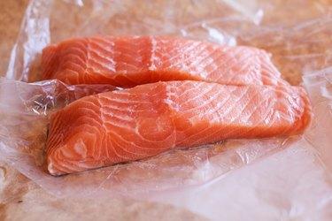 Raw salmon on butcher paper.