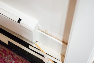 Remove curved parts of the existing baseboard