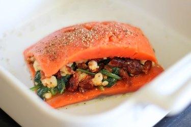 Stuffed salmon in baking dish.