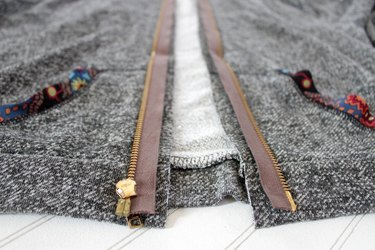 turn zipper over, place along raw edge