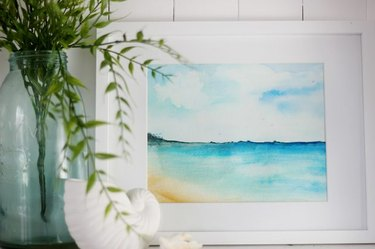 A watercolor of a beach scene.