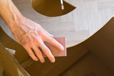 Sand any imperfections with a sanding block.