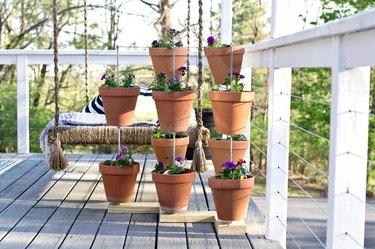 Terracotta pot vertical planter on a wooden deck